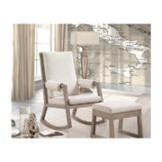 Rustic baby nursery with a map of italy wallpaper and a rocking chair with beige cushions and ottoman