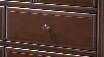 Close up of dark brown wood dresser drawer