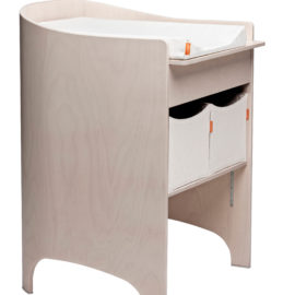 Wooden changing table in whitewash with a white mat and two white storage boxes