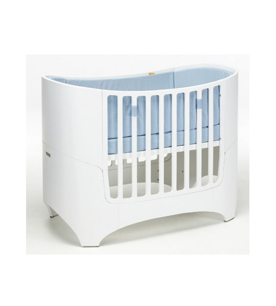 leander wooden oval sleek convertible crib in white with blue mats