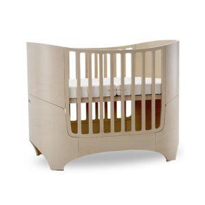 leander wooden oval sleek convertible crib in whitewash (beige)