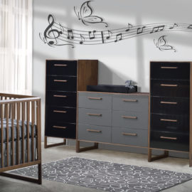 Rio Baby Room with musical notes on wall (unisex) in walnut wood with a classic crib with grey sheets, a double dresser and two 5 drawer dressers with glossy drawer facades in black and grey