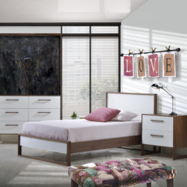 Teen girl bedroom with walnut wood twin bed, two drawer nightstand and double dresser with white glossy facades and a chalkboard wall