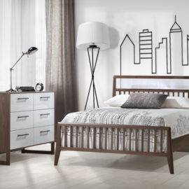 Rio Teen Room with walnut wood double bed and double dresser with white glossy facades with outline of a city skyline on wall