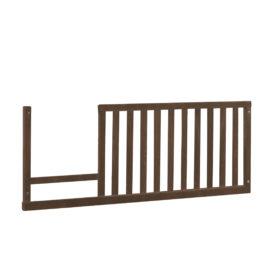 Dark brown wooden toddler gate for junior bed