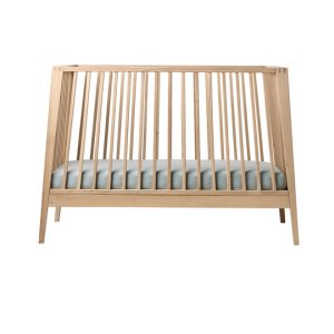 Linea wooden crib with misty blue mattress sheets