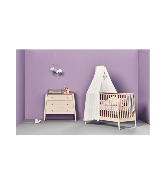 Purple baby room with linea 3 drawer dresser and crib with pink sheets