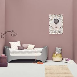 Pink Kids room with grey leander oval crib converted into a daybed