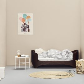 Beige baby room with the leander dark wood crib turned into a daybed