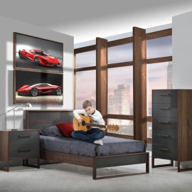 Grey teen room wth framed pictures of red sports car on walls, rio walnut wood nightstand, dresser and bed with granite grey glossy finish, teen boy sitting on bed playing the guitar