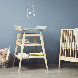 Blue bedroom with linea Crib and Changing Table in soft blue