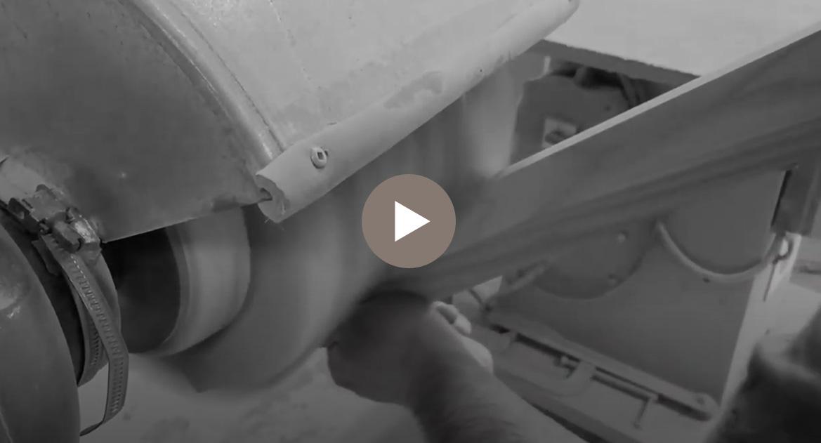 warehouse worker sanding a piece of wood