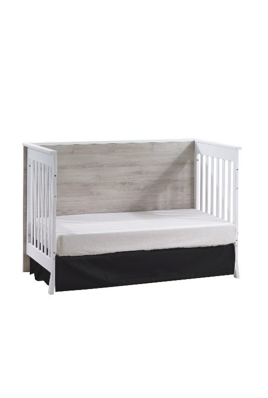 metro crib in white used as daybed