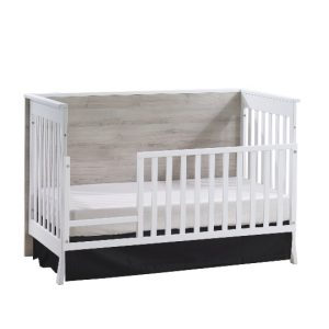 Metro crib in white used as toddler bed with gate